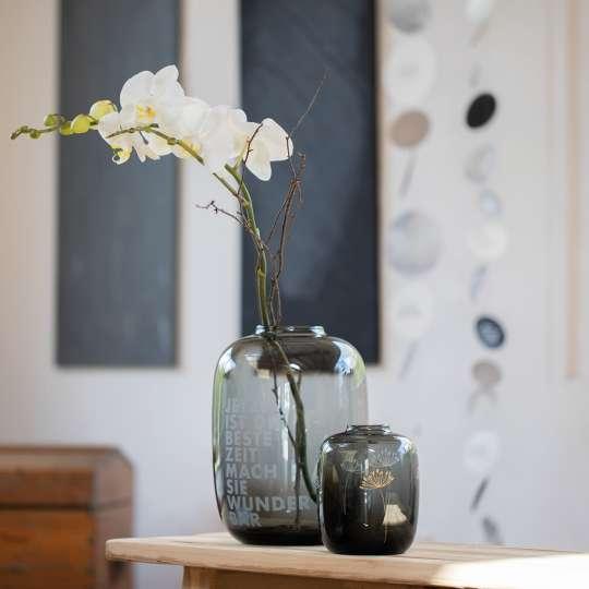 Glasvase Raum und Zeit